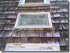 Memorials on the side of the Garrison House