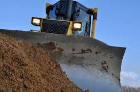 Bulldozer against dirt